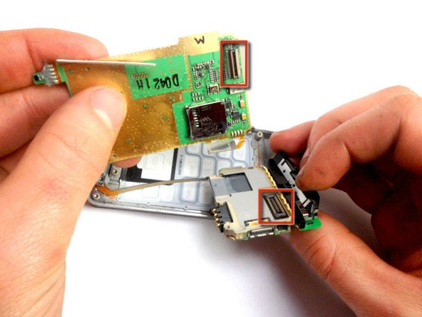 Remove the key pad from the logic board by pulling the two boards apart, separating this connection.