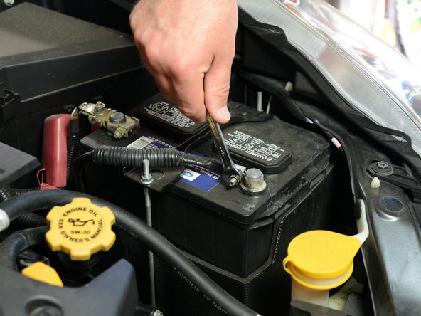 Lift the hood of your Subaru so you can access the battery.