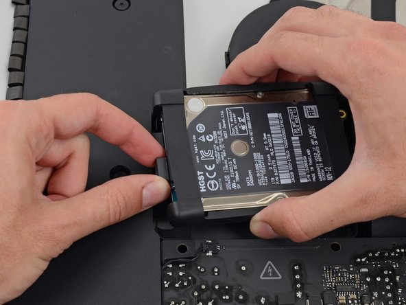Unplug the SATA data cable from the hard drive.