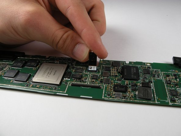 Avoid touching the lens of the camera and unplug it from the motherboard.