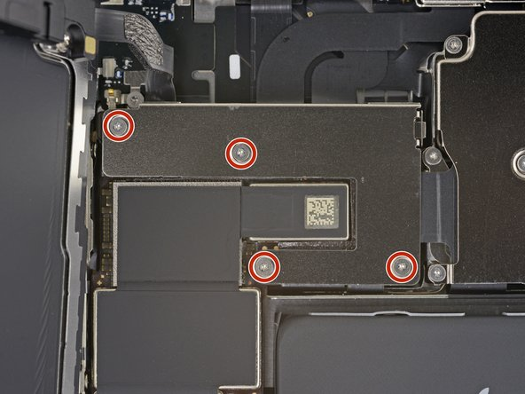 Use a Y000 driver to remove the four 1.1 mm-long screws securing the front sensor connector cover.