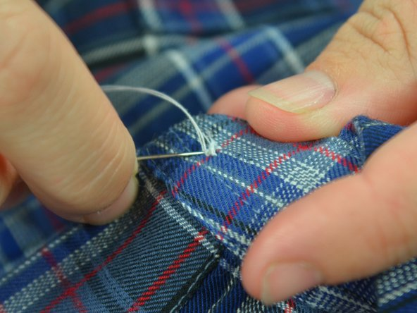 You have sewn in the button. Now you need a knot to keep the button in place.