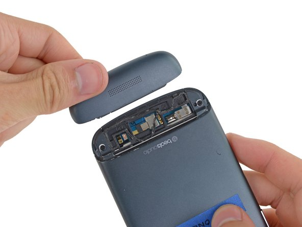 Use your fingers to pull the bottom casing off the rest of the phone.