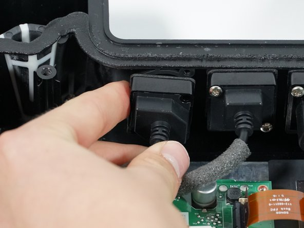Remove the Ethernet Port from the housing by pinching from both sides and pulling it out.