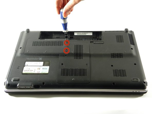 Loosen the screws from the hard drive bay cover.