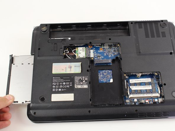 Using your hands, gently slide the optical drive out of the slot.