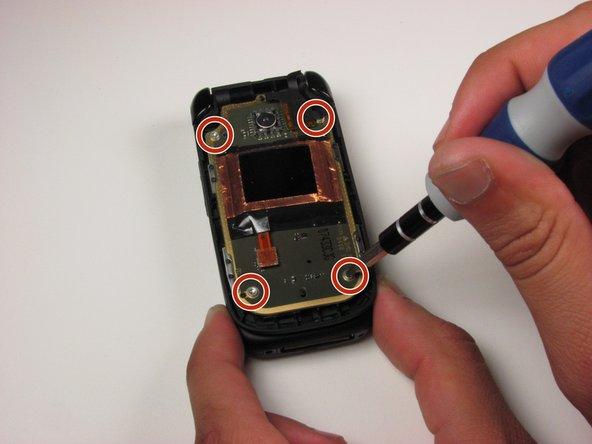 Remove the four 3.2 mm screws from the front panel using a T6 Torx screwdriver.