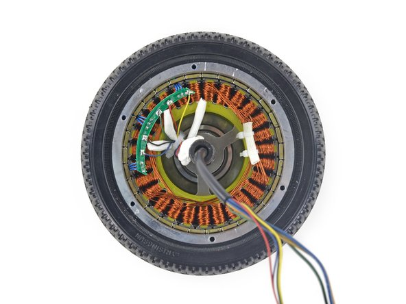 Saving the best for last(ish), we cracked open one of the mysteriously heavy wheels to get a look at the brushless DC motor.