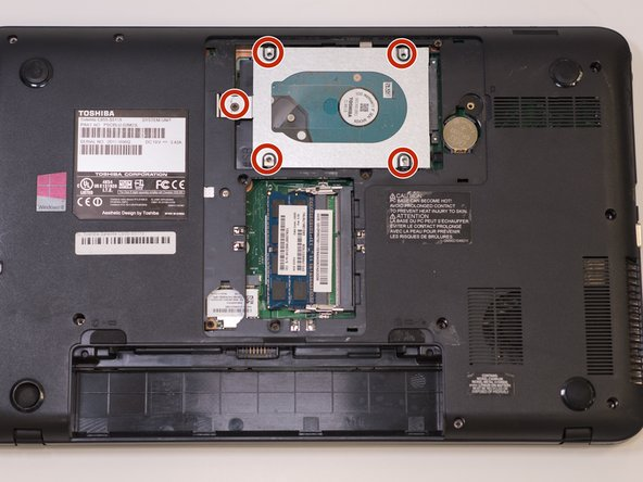 Locate and unscrew the five 3.5mm screws holding the hard drive in place using the J1S Phillips head screwdriver