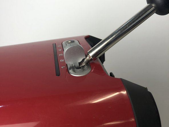 Detach the timer knob using a flat head screw driver