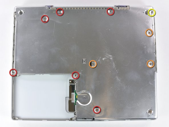 Remove the following 10 screws from the bottom shield: