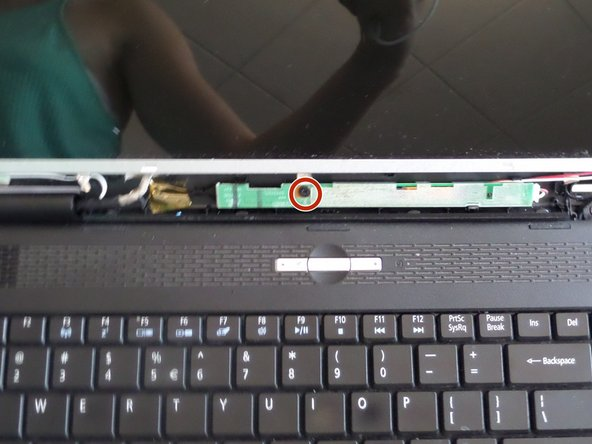Unscrew the middle screw on the green strip under the screen.