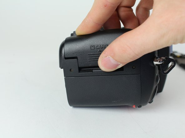 Open the SD card cover by pushing slightly down with your thumb and sliding up.