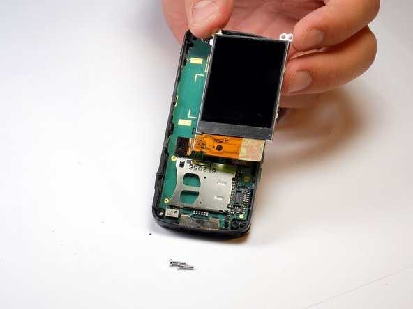 Pull LCD screen gently out and the to side.  Do not attempt to pull it completely away from the board below it.