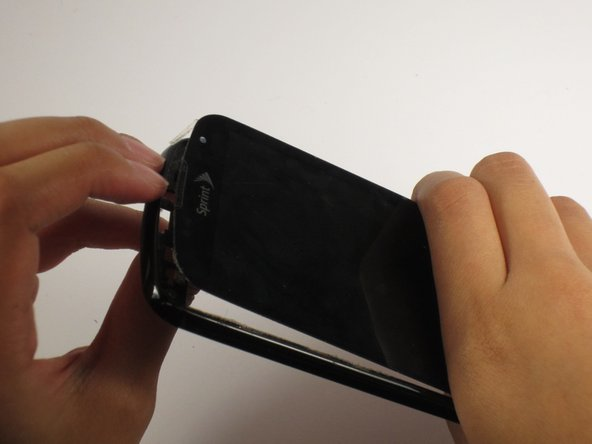 Carefully pull apart the frame and the screen.