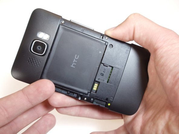 Carefully pull the rear cover from the back of the phone.