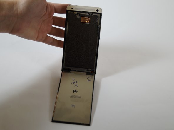 Once the screen has been loosened on the top, left and right edges, lift the screen.