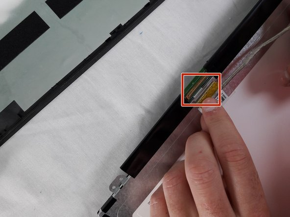 Lift up plastic over latch for the screen.