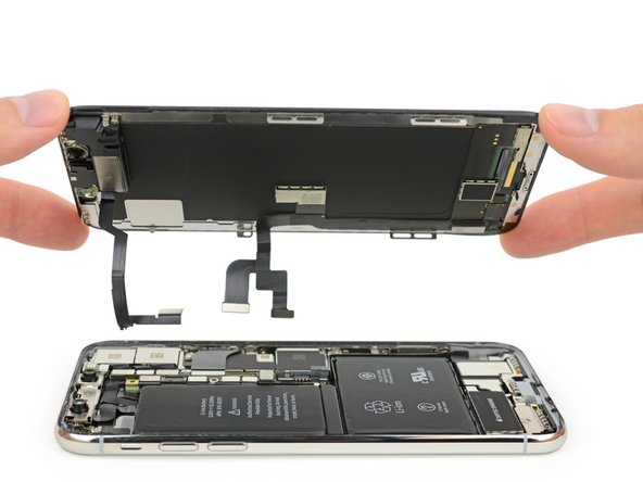 After freeing the massive unibracket from the logic board, we can finally steal a peek at the hardware powering Cupertino's latest flagship.