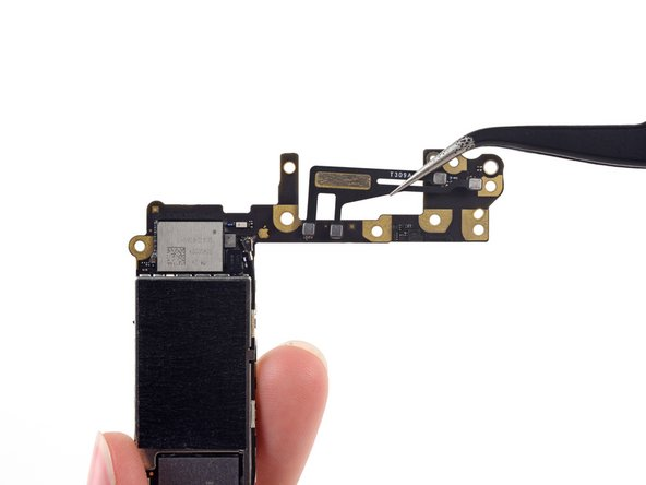 Flip the logic board over to expose the antenna on the back side.