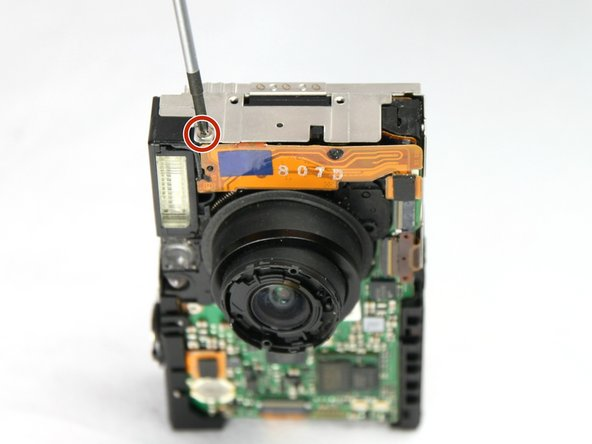 Use a Phillips #00 screwdriver to remove the 2.4 mm screw that secures the flash assembly.