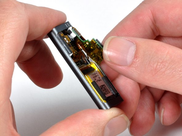 Removing the internals. There's a single connector that attaches the logic board and battery to the rest of the iPod.