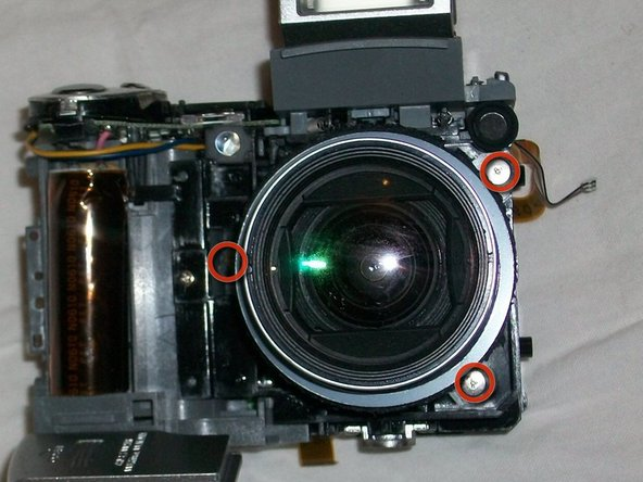 Turn camera over so that lens is facing you.