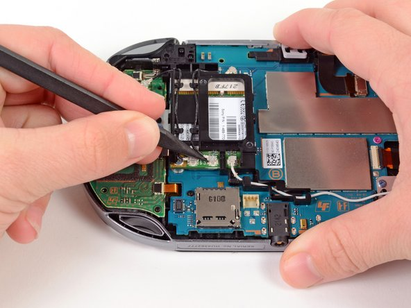 Using the pointy end of the spudger, gently pry the GPS antenna cable off the wireless card.