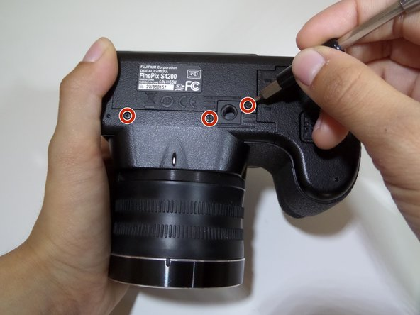 Remove the three 4 mm screws from the bottom of the camera with a Phillips #000 screwdriver.