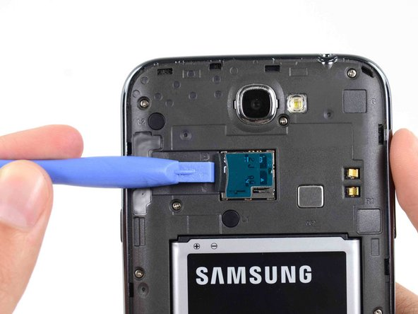 If you have an SD card inserted, use the flat end of a spudger, or your fingernail, to press the microSD card slightly deeper into its slot until you hear a click.