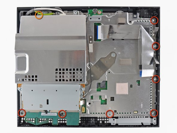 Remove the following eight screws securing the motherboard assembly to the lower case: