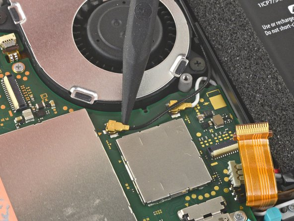 Use the point of a spudger to pry the black antenna cable straight up out of its socket on the motherboard.