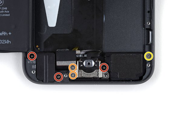 Remove the following screws securing the headphone jack, Lightning connector, and speaker.