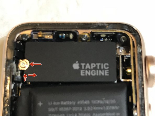 A Tri-Wing Y000 screw (.6 mm) holds an adhesive label on top of the Taptic Engine.  The label also hides the connector for the Force Touch Gasket.  Remove the screw and peel up the label.  It takes a little effort to peel the cover/label due to some adhesive.