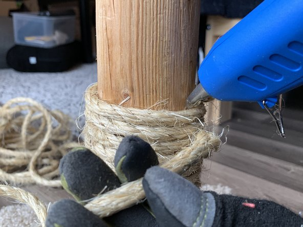 Take the new sisal rope and glue the end to the post right where the old rope left off.