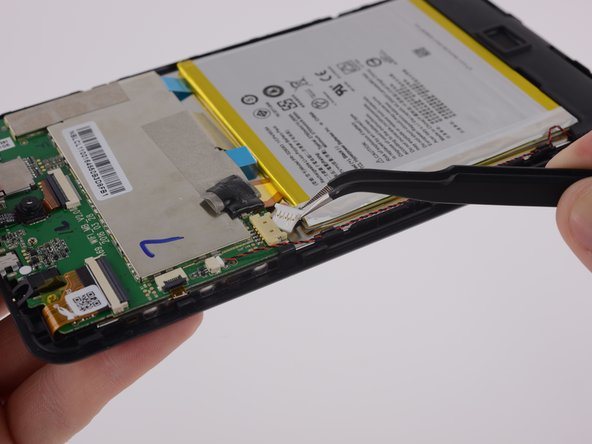 The battery cable runs short and requires a careful and precise wiggle to remove its connection from the motherboard.