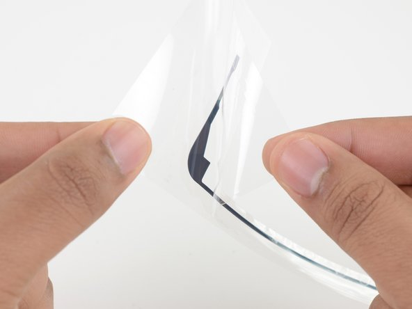 Repeat the process with the right adhesive strip.