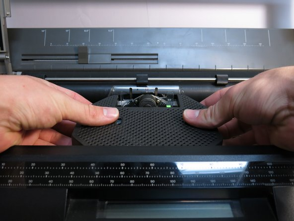 Gently lift to remove the old ink cartridge.