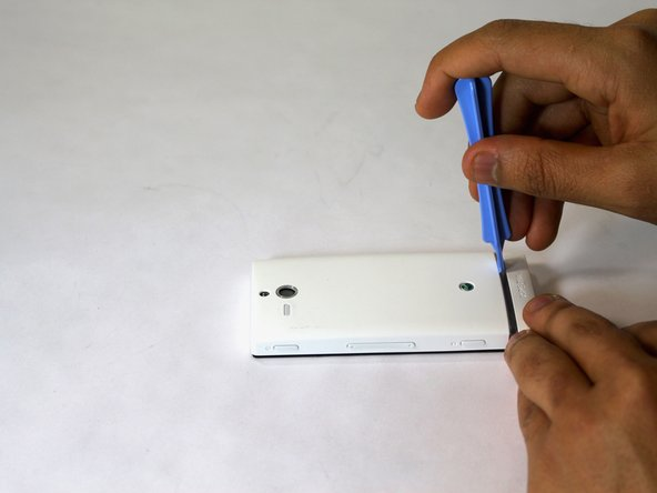 Set the phone screen down on a clean flat, surface.