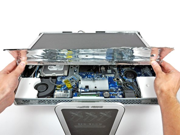 Lift the lower edge of the display and rotate it toward the top edge of your iMac.