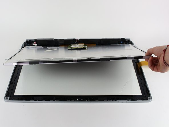 Gently pull the display free from the digitizer with your hands.