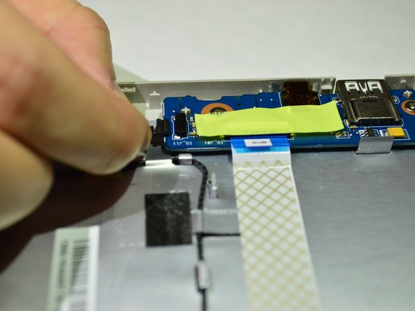Carefully unplug the speaker's cord from the I/O board.