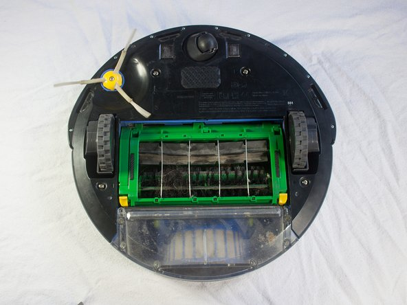Place your Roomba upside-down on a hard surface.