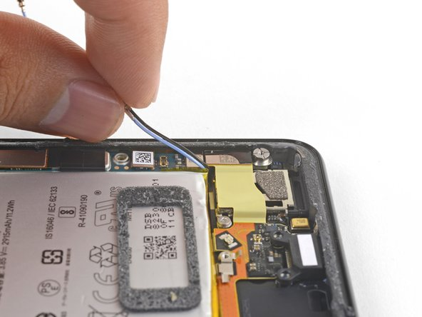 Carefully de-route both antenna cables and move them away from the charging assembly.