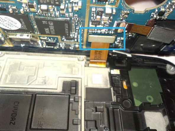 Now, lift from the right side the board, and be careful, below is the LCD connector.