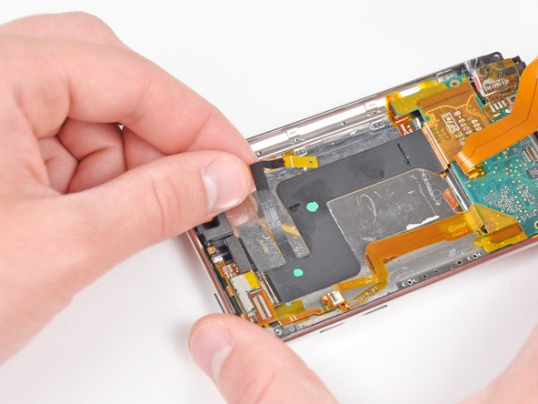 Carefully peel the antenna cable off the adhesive securing it to the rear panel.