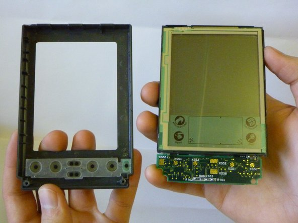 The front plastic cover is now free to be removed from the rest of the device.