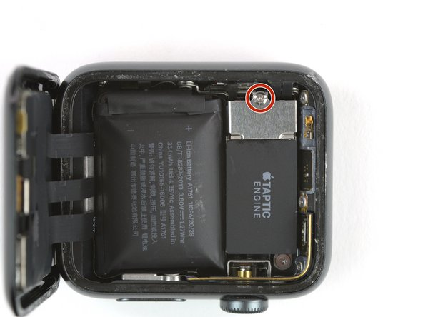 Use a Y000 driver to remove the Tri-point screw securing the metal battery connector cover.