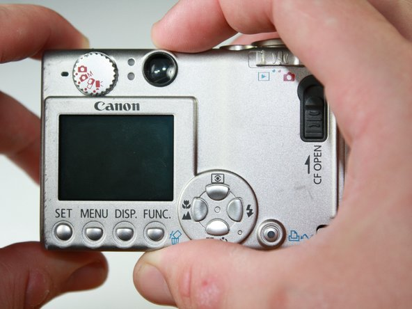 Turn the camera with the back side facing you.