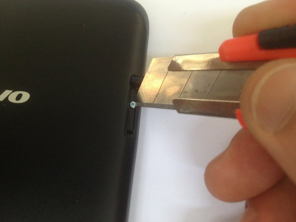 Unscrew the two Phillips screws under the memory card and the SIM card covers.